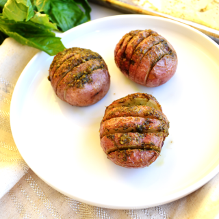 Pesto Hasselback Potatoes - I like to use red potatoes for this healthy side dish! Whole30 approved and SO tasty!