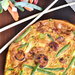 This Asian Stir-Fry Frittata is a great way to mix up your eggs in the morning!! A whole 30 approved and paleo breakfast that you will crave!  Easy to make with frozen veggies!