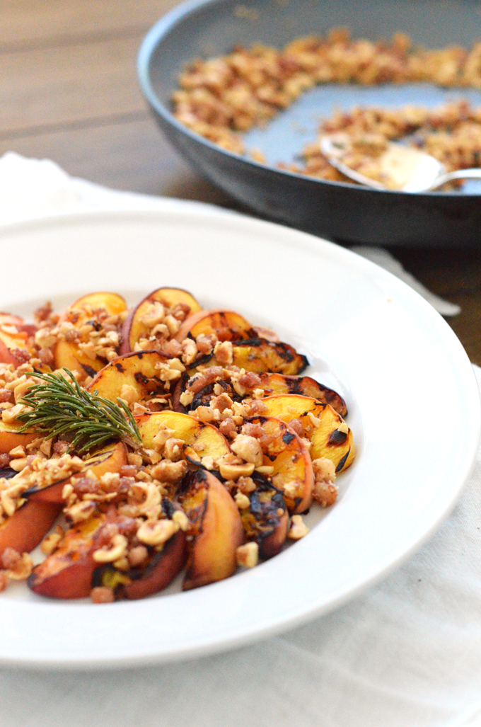 Grilled Peaches with Hazelnut Pancetta Crumble! A perfect summer dessert or appetizer for a dinner party or celebration! A paleo and whole30 option for everyone to enjoy!