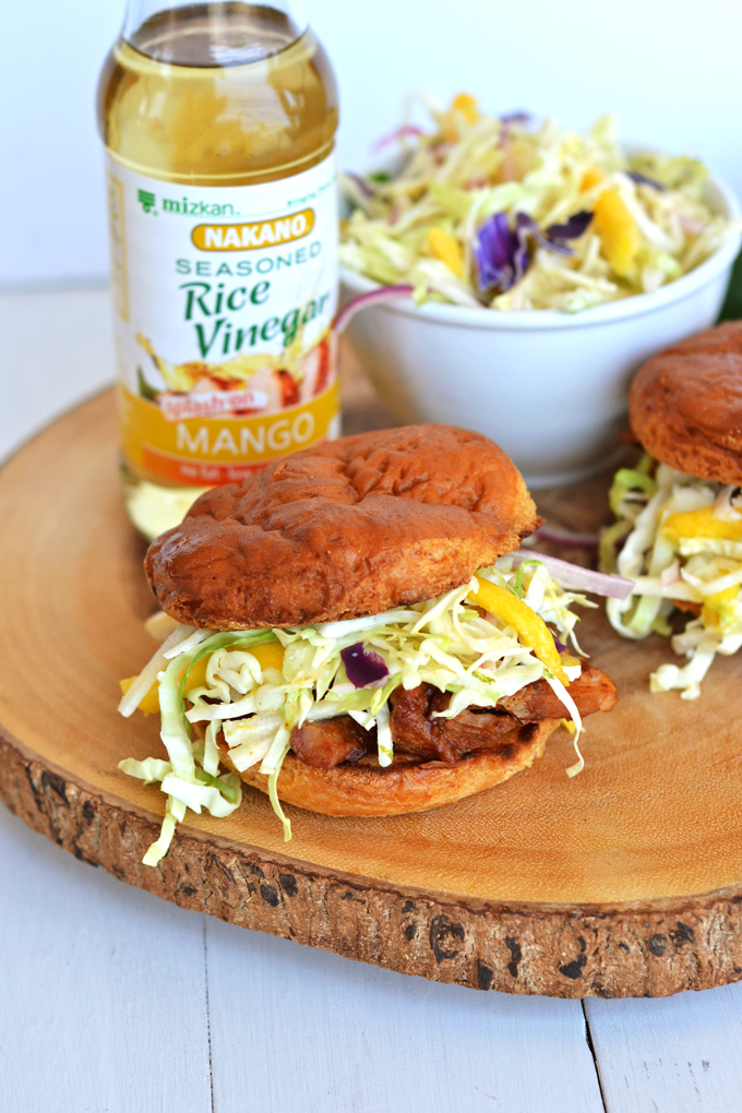 This Mango Jicama Coleslaw is a perfect side dish or topping for a pulled pork sandwich! Nakano Mango Rice Vinegar adds tons of Mango flavor!