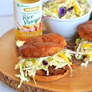 This Mango Jicama Coleslaw is a perfect sided dish or topping for a pulled pork sandwich! Nakano Mango Rice Vinegar adds tons of Mango flavor!