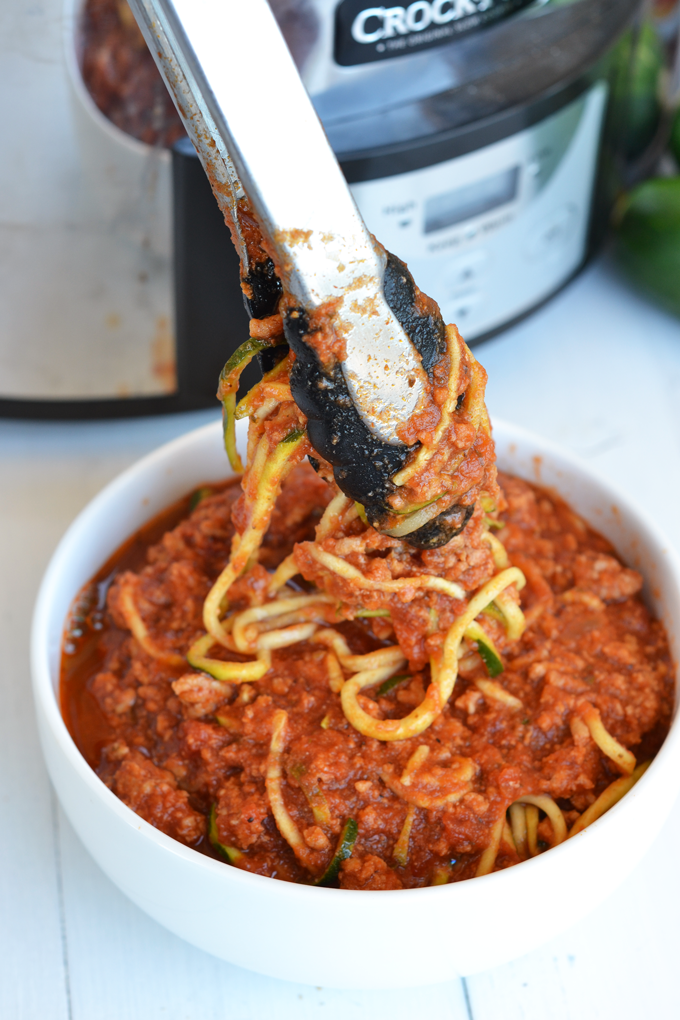 This Slow Cooker Turkey Bolognese and Zucchini Noodles are the perfect quick, easy and healthy weeknight meal! Just a few ingredients and it is Paleo & Whole30 compliant!