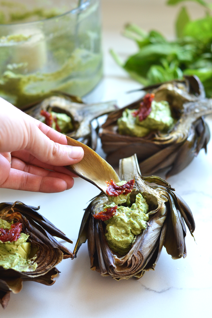 This Avocado Pesto Roasted Artichokes recipe is the perfect, healthy and beautiful appetizer for any occasion! It is whole30, paleo and dairy free!