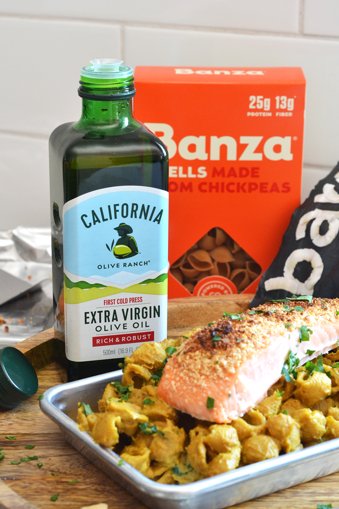 This Cashew Coconut Crusted Salmon over Creamy Curry Pasta Recipe is a dairy free and grain free dinner that is healthy and delicious!