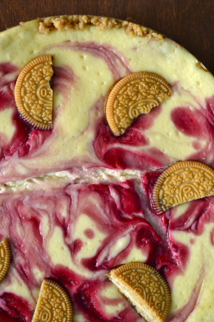 This Raspberry Cheesecake w/ Golden Oreo Crust is quite the decadent treat! If you want to impress your friends and family with a delicious sinful dessert, you have to give them this!