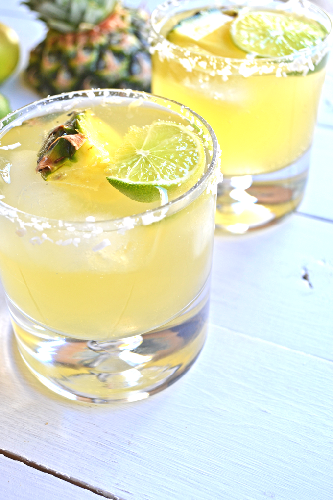This Skinny Tequila Squeeze is the perfect way to have a drink without the guilt! Coconut water, pineapple juice and lime make a super refreshing mix!