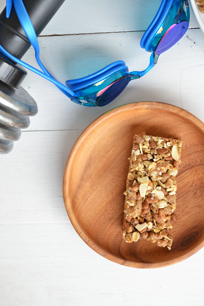 These Protein Packed Granola Bars are refined sugar free and gluten free! Almonds, nut butter & protein powder make these perfect for a pre-workout snack!