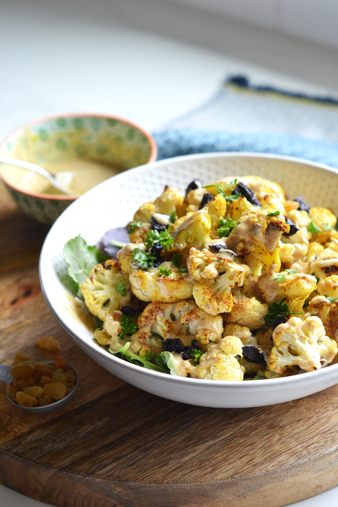 This Curry Charred Cauliflower with Honey Spice Yogurt Sauce is made Paleo & dairy free with almond milk yogurt and lots of cinnamon, turmeric and curry powder!