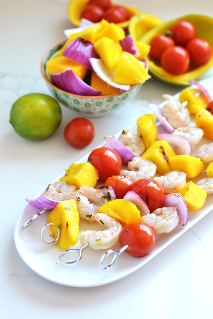 These Grilled Mango Shrimp Skewers are the perfect fresh and healthy way to barbecue this Summer! A cilantro lime sauce finishes it off beautifully!
