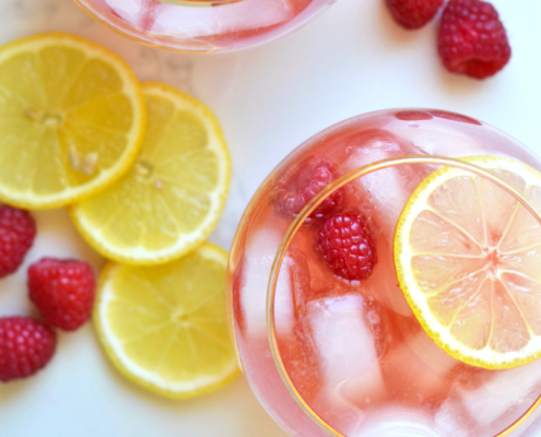 This Raspberry Lemon Kombucha Sangria is the perfect fresh way to celebrate the summer! Packed with flavor and probiotics!