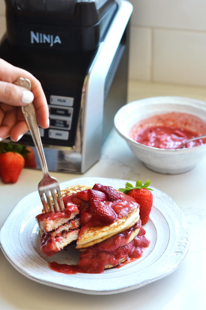 This Roasted Strawberry Vanilla Bean Sauce goes perfectly with these paleo and vegan pancakes and both recipes come together in a ninja blender!