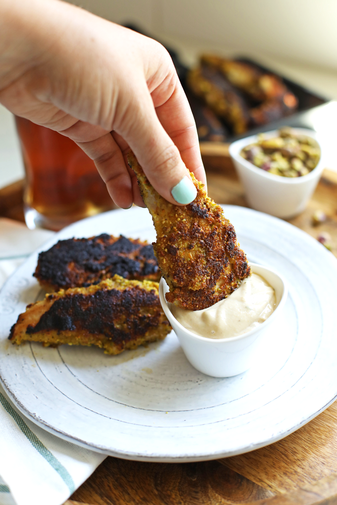 These Garlic Pistachio Chicken Tenders with Rosemary Tahini Dipping Sauce are Whole30 and perfect for an easy weeknight dinner!