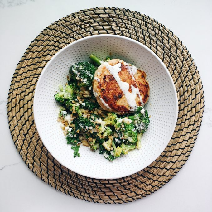 Whole30 approved lunch - sauteed broccoli, kale and cauliflower rice with a Tribali chicken patty on top!