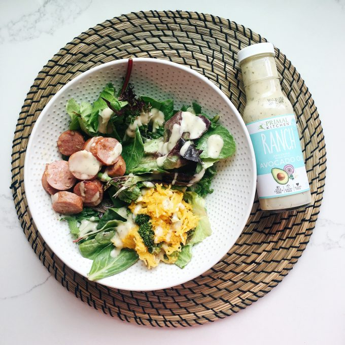 Whole30 Approved Lunch - Salad with leftovers and chicken apple sausage topped with Primal Kitchen Ranch dressing!