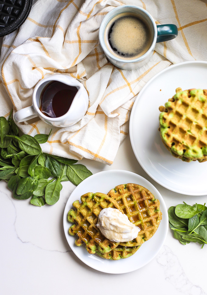 These Spinach Almond Flour Waffles are a simple paleo breakfast that the whole family will love! Perfect for sneaking in extra veggies in a delicious way!