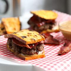 This Peanut Butter Jelly and Bacon Burger on Sweet Potato Toast is the perfect combination of salty and sweet!