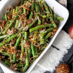 These Green Beans with Sweet Dijon Sauce and Crispy Shallots are a super easy whole30 side dish that everyone will love!