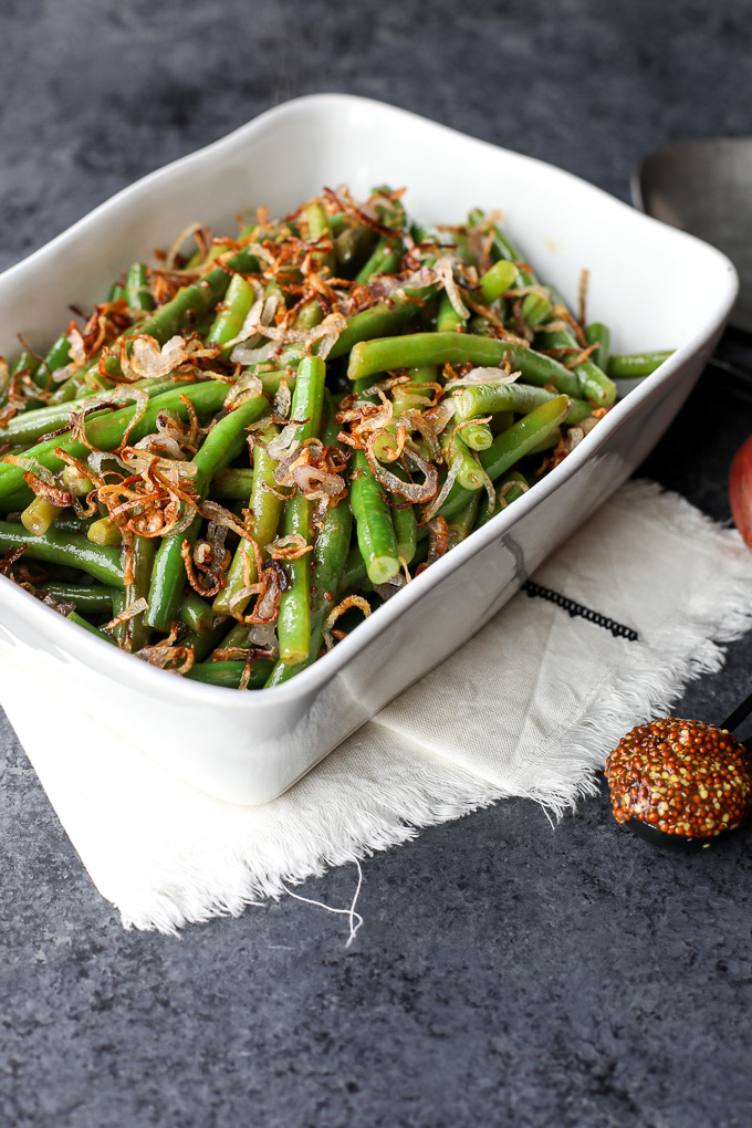 These Green Beans with Sweet Dijon Sauce and Crispy Shallots are a super easy paleo side dish that everyone will love!