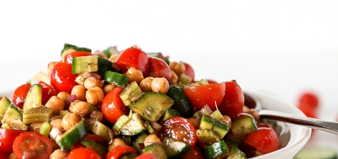 This Mediterranean Veggie & Chickpea Salad is a fresh and nourishing side dish that is great for any potluck or or to prep for the week!