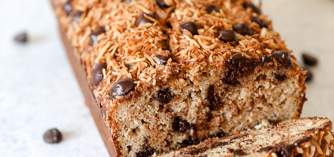 This Paleo Toasted Coconut Chocolate Chip Banana Bread is the perfect treat that is free from dairy, grains and refined sugar!