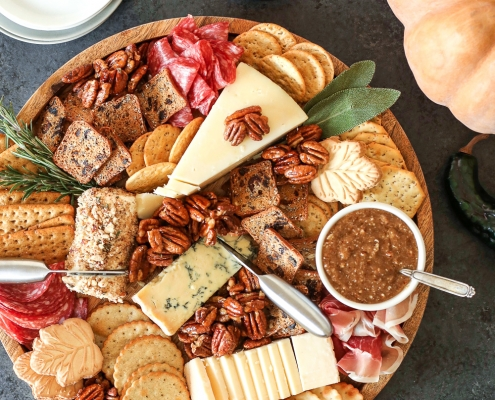 This Thanksgiving Charcuterie Board has Maple Sage Pecans, a Rosemary Pecan Crusted Goat Cheese and a Honey Cinnamon Pecan spread that will wow any crowd this holiday!