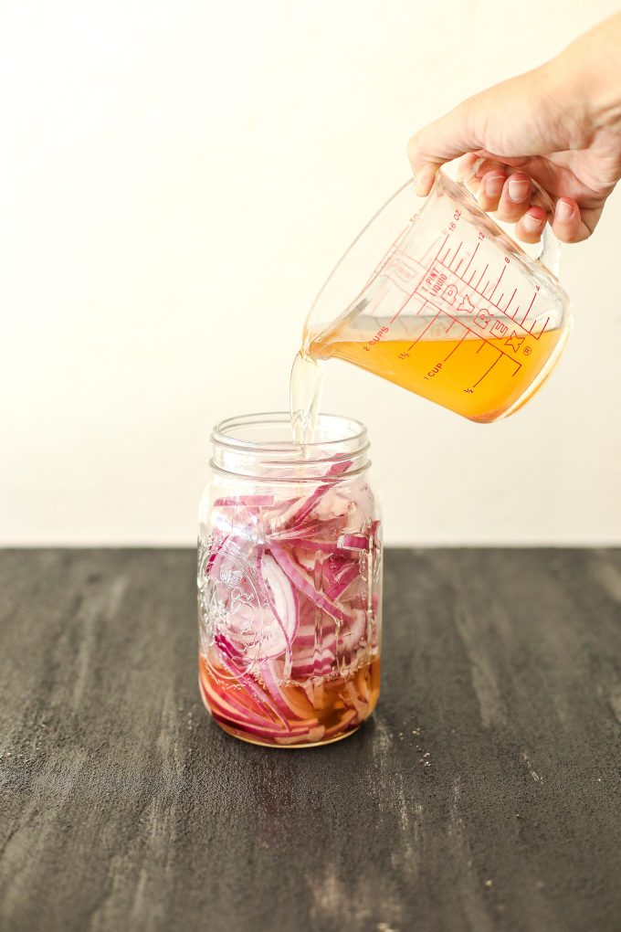 These Paleo Pickled Red Onions are a great topping to salads or any meal and made without refined sugar!